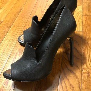 BCBG black glazed goat shoes